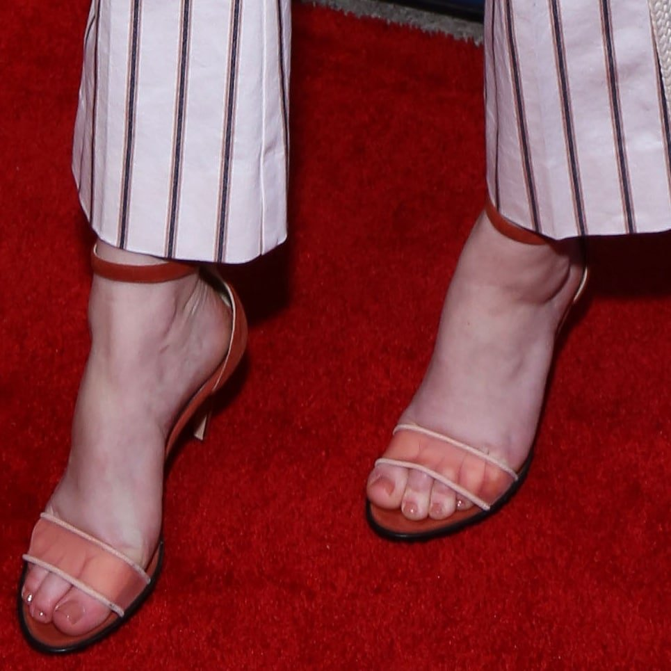 Rachel Brosnahan highlighted her feet and toes in red semi-transparent sandals