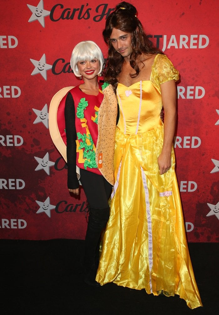Sarah Hyland dressed as a taco and Wells Adams as Beauty & the Beast's Belle, making them Taco Bell