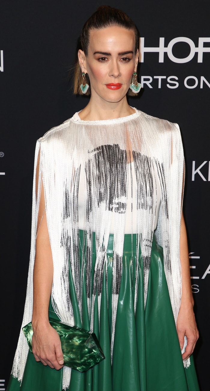 Sarah Paulson wears a white tank top featuring a printed fringe panel with Andy Warhol's Stephen Sprouse portrait