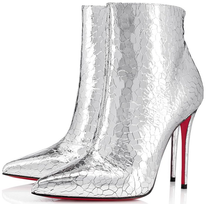 The pointed-toe model set on a 100mm stiletto heel offers a high upper complemented with a zip on the inner side