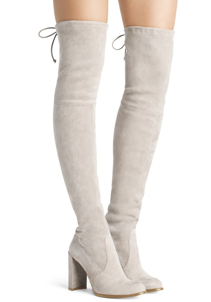 Over-the-knee boots are a fashion staple, and these tantalizing thigh-highs are elevated with a straight block heel and finished with Stuart Weitzman's signature tie back detail for a flawless fit