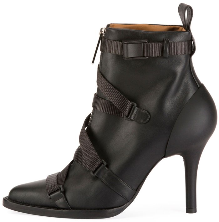 These calf leather boots are made in Italy with a pointed toe, feature black grosgrain straps crossed over the zip-fastening front, and are lined with brown leather