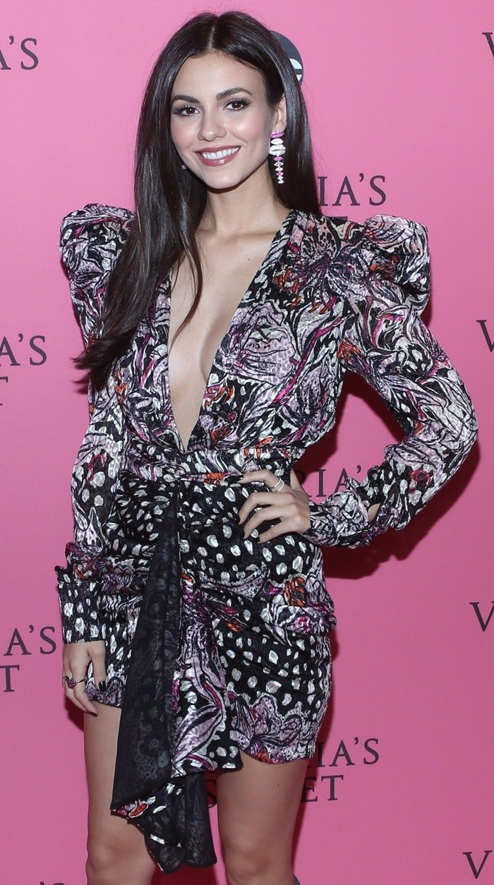 Victoria Justice wearing a revealing silk dress from the Dundas Spring 2019 Collection and colorful APM Monaco earrings