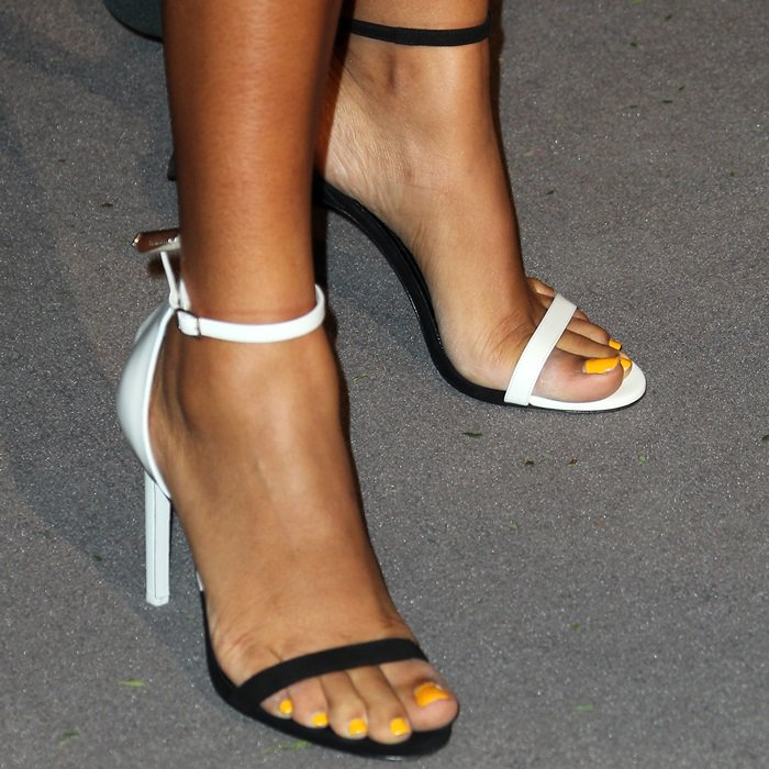 Yara Shahidi shows off her feet in mismatched Camran two-tone sandals by Calvin Klein 205W39NYC