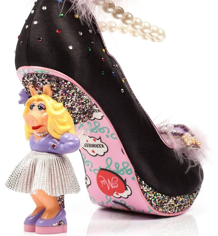 A faux pearl ankle strap, shiny heart decal, multi-glittered platform, and tiny rhinestone embellishments combine to create a dramatic shoe that refuses to be ignored