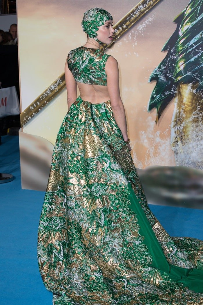 Amber Heard ina green gown with a matching cap from Valentino