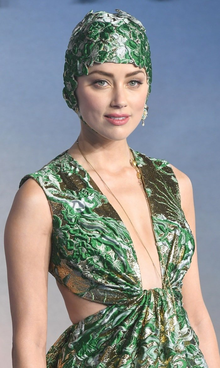Amber Heard looked like the Queen of Atlantis in a green and gold shimmering gown