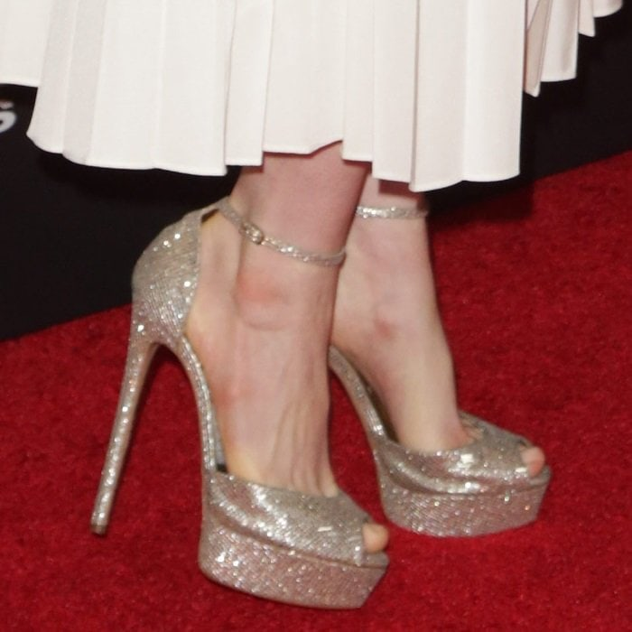 Anne Hathaway shows off her feet in platinum glitter Casadei peep-toe platforms