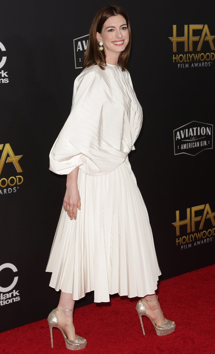 Anne Hathaway donned a bedsheet-inspired Valentino Spring 2019 dress