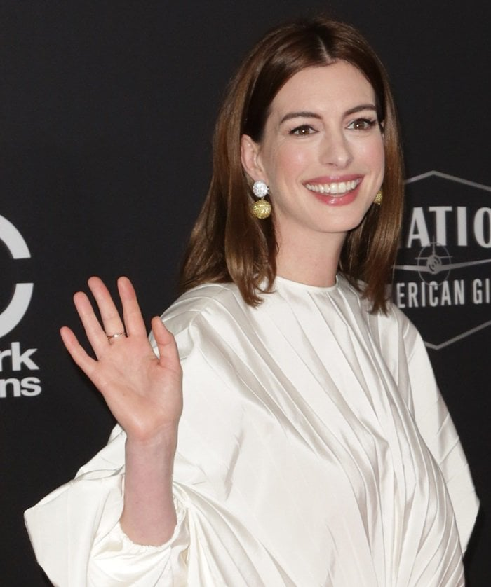 Anne Hathaway wearing sustainable lab-grown yellow sapphire diamond earrings by Anabela Chan