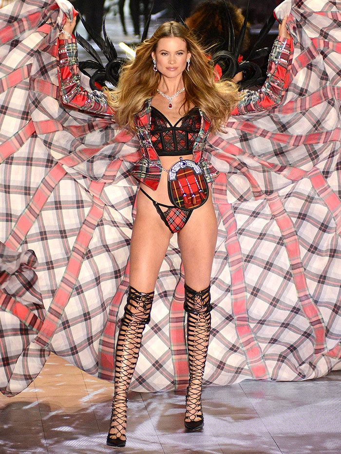 Behati Prinsloo making her return to the Victoria's Secret Fashion Show in corset-lace-up black-leather over-the-knee boots