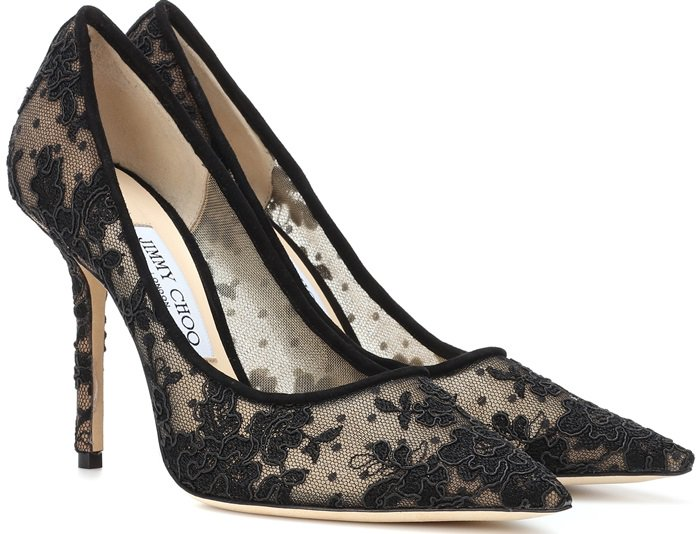Crafted in Italy, the pointed-toe design is presented in black floral lace against a dotted Swiss tulle background, with a leather sole and lining providing comfort.
