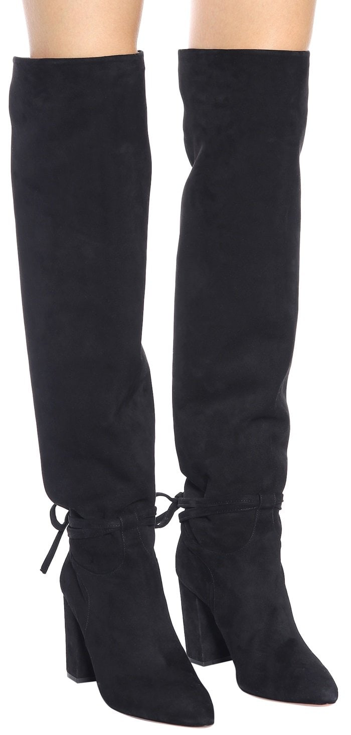 A knee-high boot with the kind of sophisticated slouch that usually takes years to achieve is made from buttery soft kid suede.
