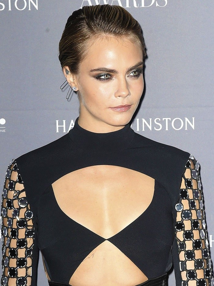 Cara Delevingne wearing paperclip bobby pins in her short, slicked-back hair