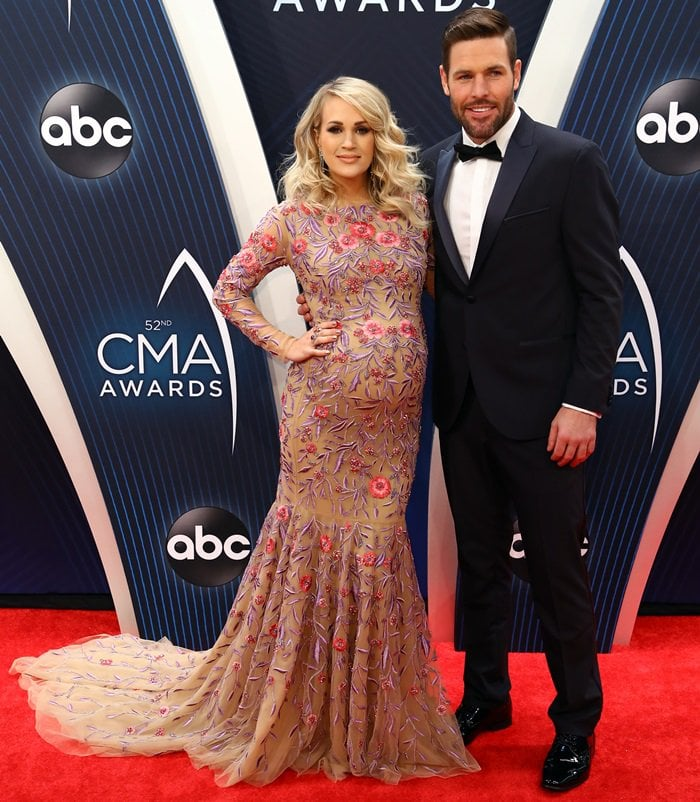 Carrie Underwood and Mike Fisher on the red carpet at the 2018 CMA Awards
