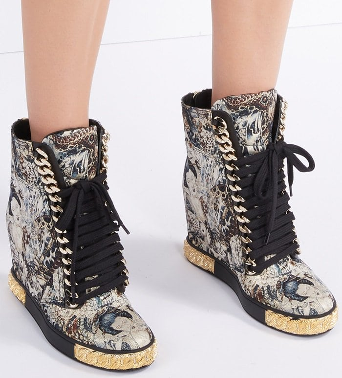 Featuring a Japanese painting of a geisha, beautiful chain embellishments enhance the upper of these artistic sneakers