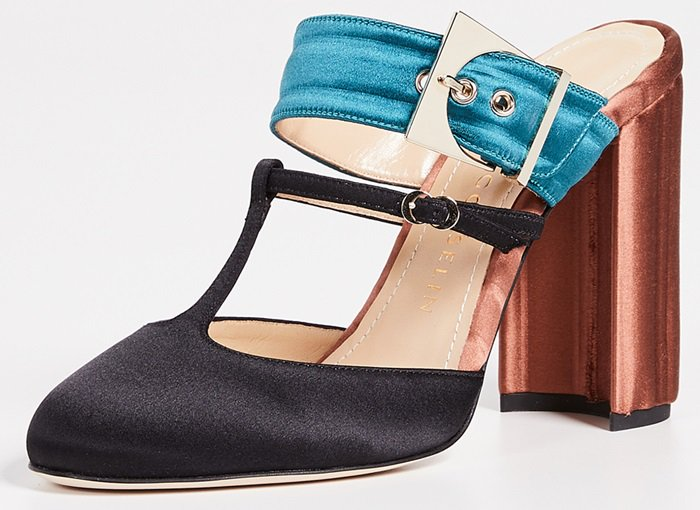 Teal, copper and black leather and silk crepe Olympe mules from Chloe Gosselin featuring an almond toe, a T-strap to the front, a side buckle fastening, a branded insole, a backless design, a branded insole and a high block heel.
