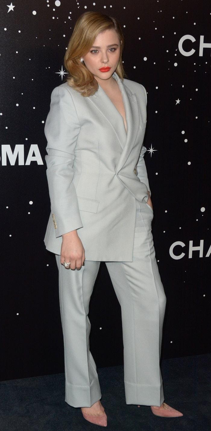Chloë Grace Moretz wearsBulgari jewelry and Jimmy Choo Bing pumps