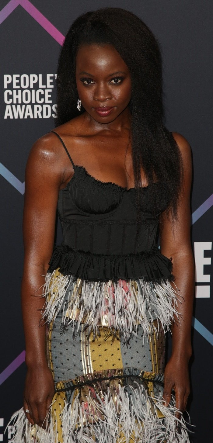 Danai Gurira wearing a beaded fringe and feathered Brock Collection dress