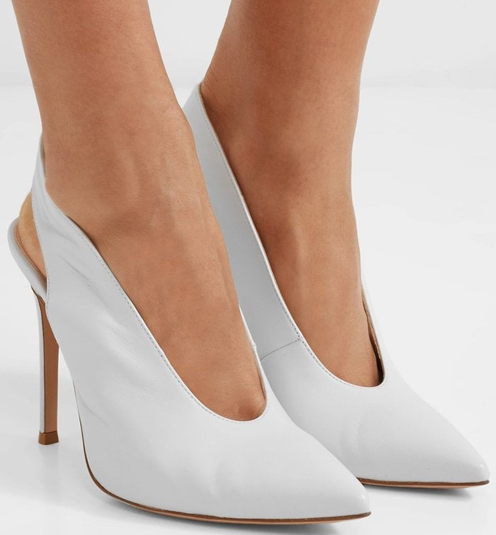 A flash of white is the easiest way to freshen up an outfit. Gianvito Rossi's pumps are made from supple leather with a classic pointed toe and slingback silhouette