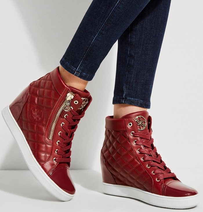 Step up your style game with these faux-leather quilted wedge sneakers with a lace-up front and high-top design
