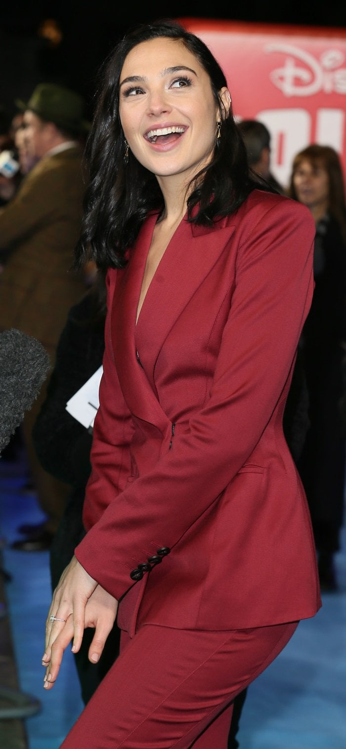 Gal Gadot's maroon-hued Mugler suit featuring padded shoulders and matching wide-leg pants