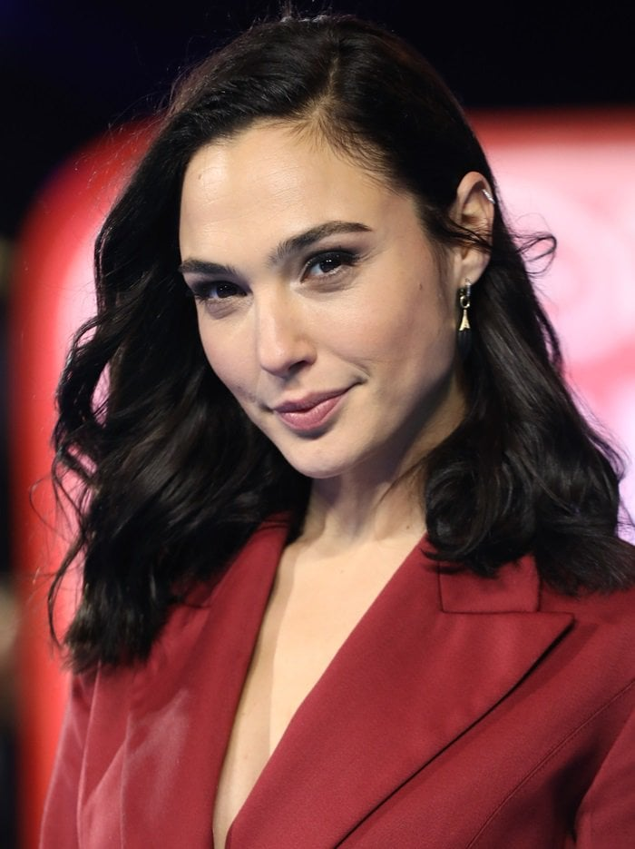 Gal Gadot with side-parted tresses at the Ralph Breaks The Internet premiere held at The Curzon Mayfair in London, England, on November 25, 2018