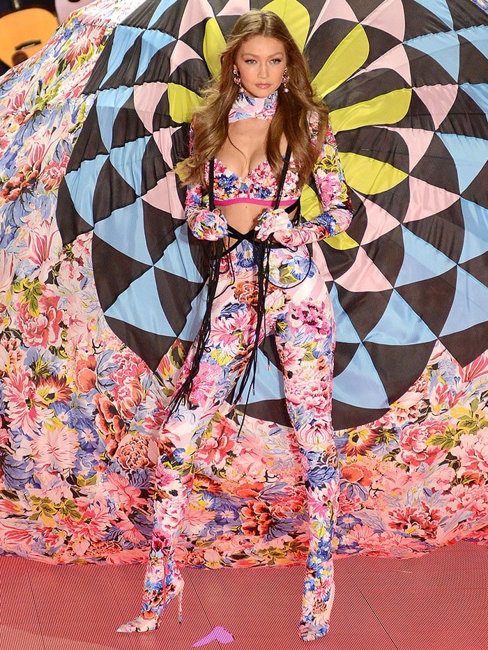 Gigi Hadid in a floral, parachuter-themed ensemble and matching pink-and-blue floral ankle boots