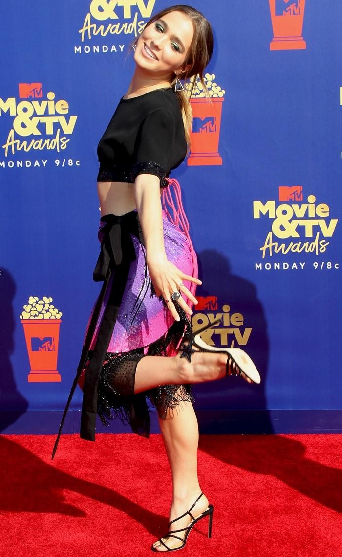 Haley Lu Richardson proudly shows off her crystal-embellished star Lynn sandals