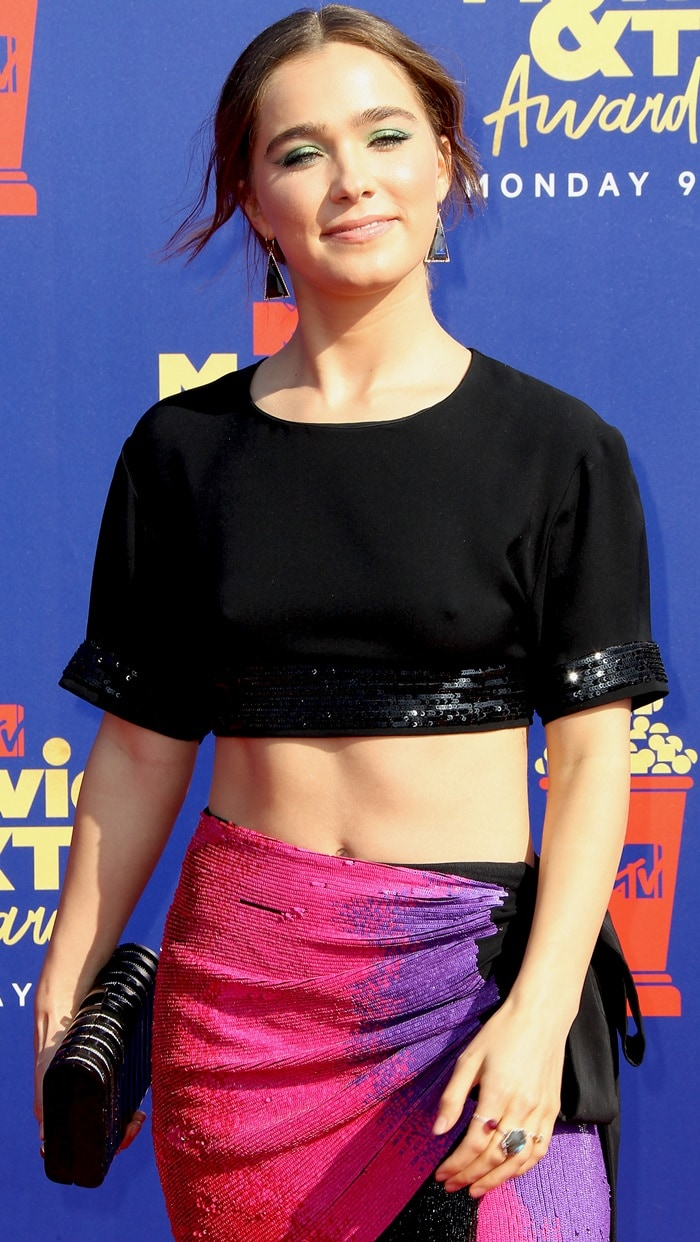Haley Lu Richardson flashed her belly button in a black crop top and pink skirt