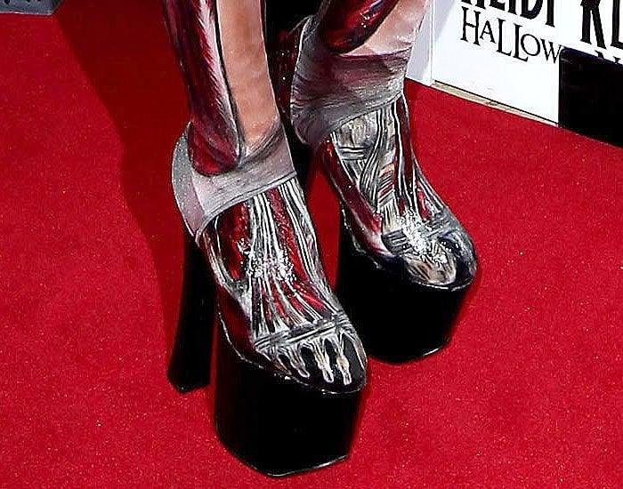 Closeup of Heidi Klum's skinless, skeletal platform boots