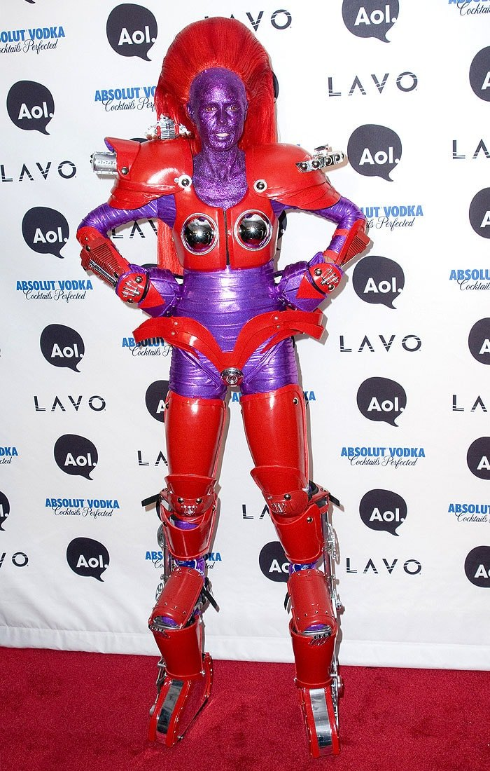 Heidi Klum dressed as a red-armored, glittery purple robot for Halloween 2010