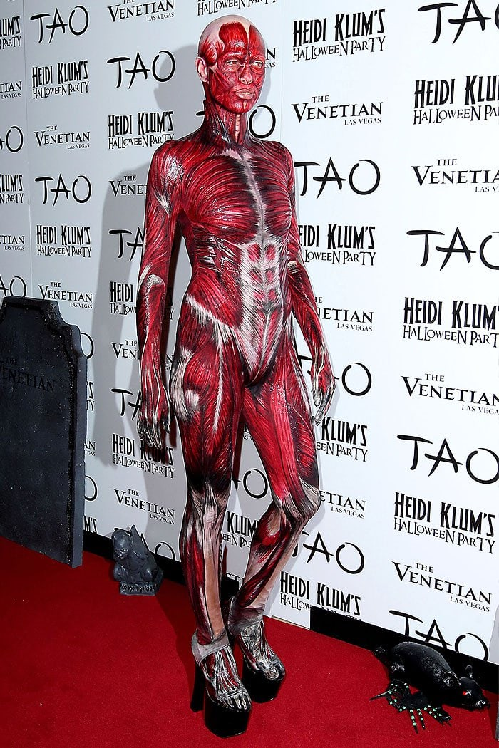 Heidi Klum as a dead body with peeled-off skin at her 2011 Halloween Party