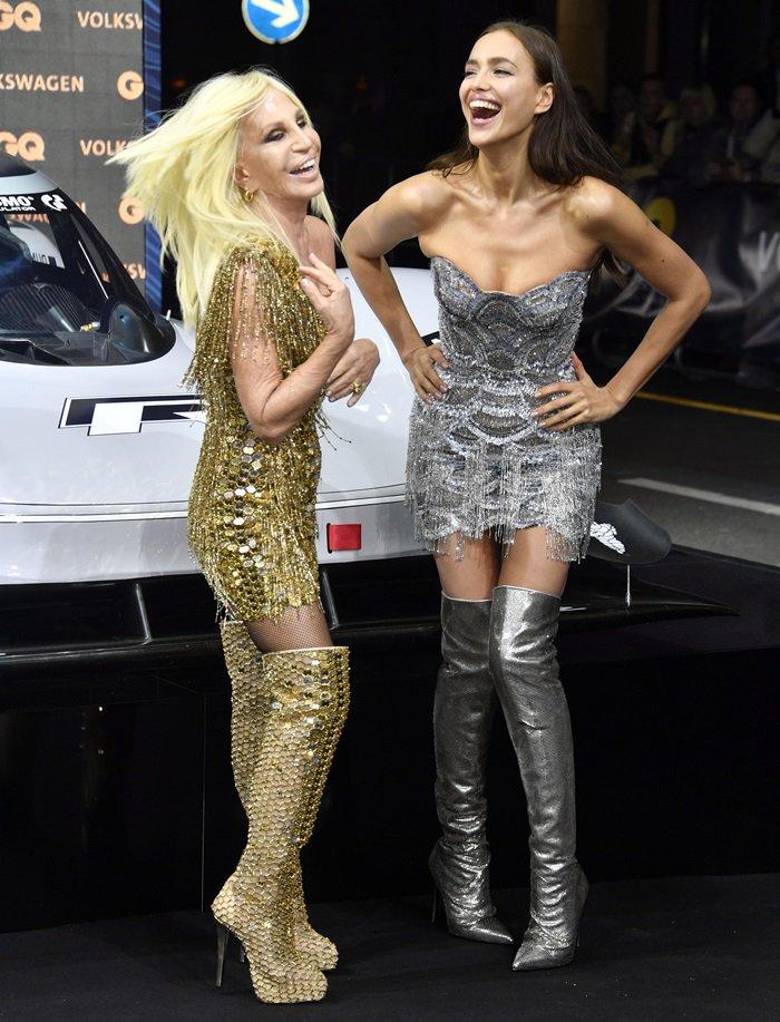 Donatella Versace and Irina Shayk twinning in glittering mini dresses and boots