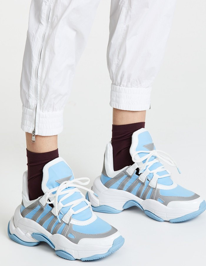 Layered mesh amps up the sporty attitude of a tech-look sneaker styled with angled racing stripes anchoring the lacing to the dramatically flared platform sole
