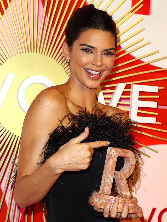 Kendall Jenner accepting her Icon of the Year award at the 2nd Annual Revolve Awards
