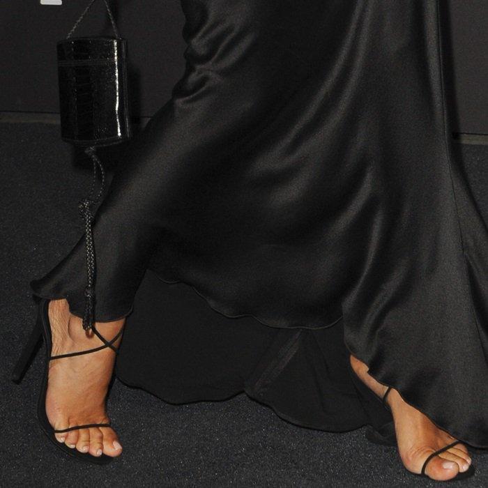 Kim Kardashian shows off her feet in black sandals