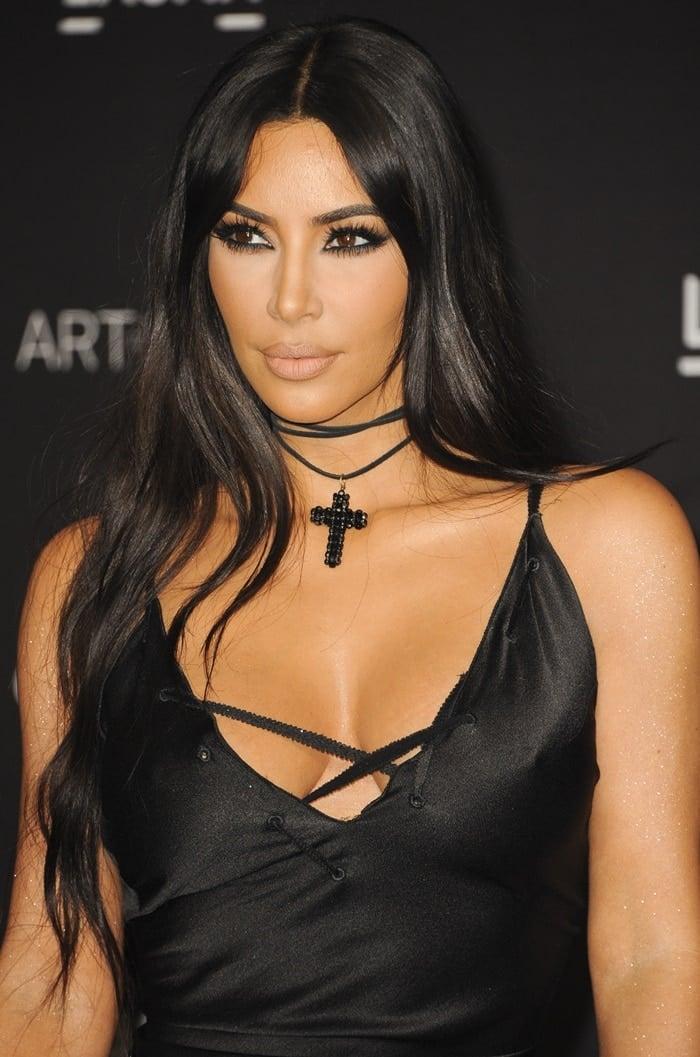Kim Kardashian accessorized with across-shaped necklace