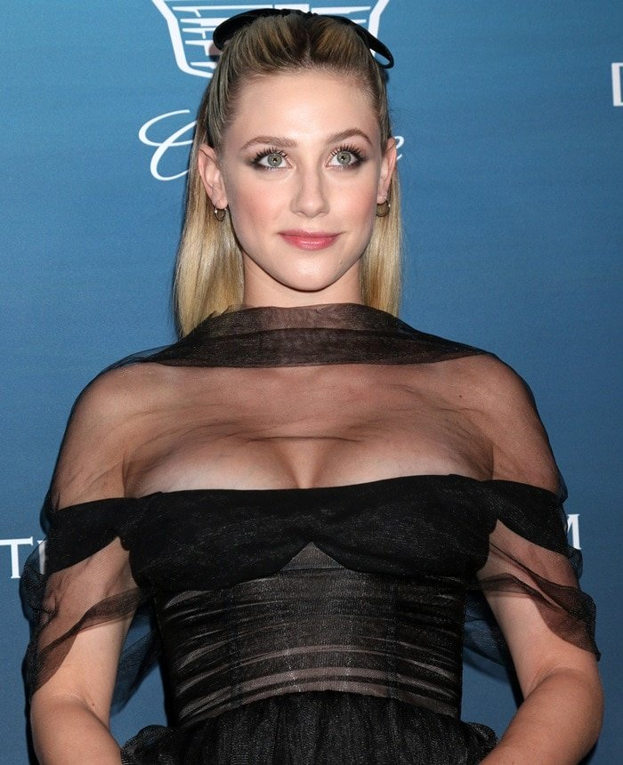 Lily Reinhartsquished her boobs in a Rasario tulle gown