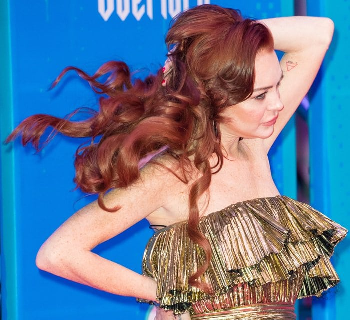 Lindsay Lohan rocked her signature fiery red hair in loose curls