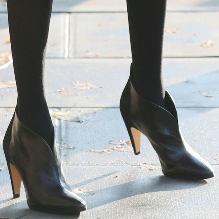 Meghan Markle styled her heeled booties with black stockings