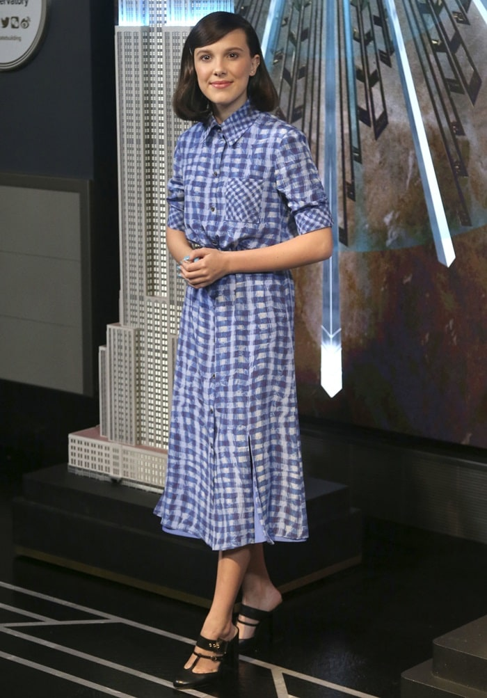 Millie Bobby Brown flashes her legs in a blue, plaid Altuzarra Spring 2019 dress