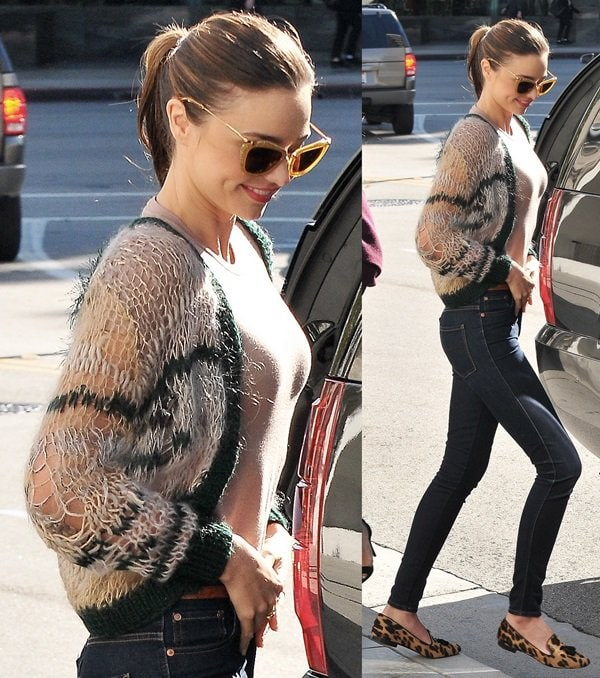 Miranda Kerr wearing a cropped knit sweater and dark-washed skinny jeans