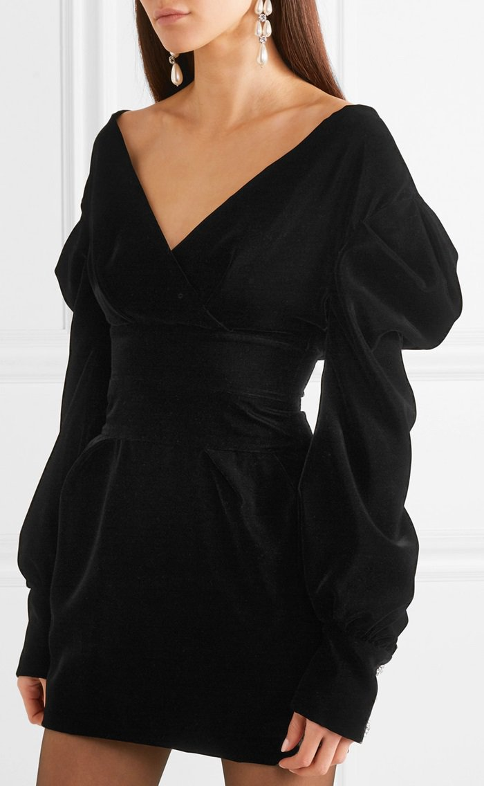 Made from sumptuous black velvet, this off-the-shoulder mini dress is accented with retro puffed sleeves and sparkling crystals.