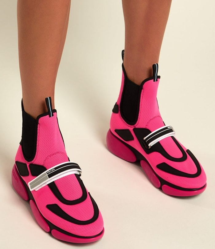 These pink Prada high-top Cloudbust trainers are appealing to the house's futuristic aesthetic