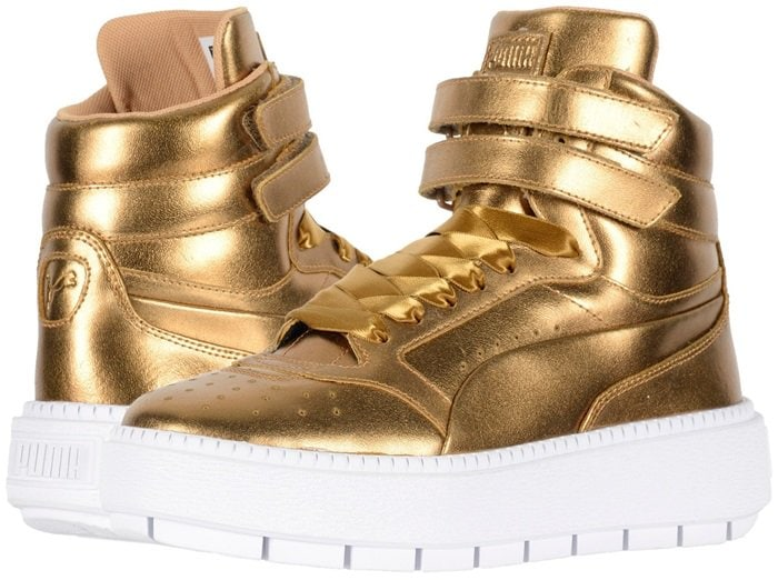 This luxe edition features a metallic foiled hi-top upper with straps across for a snug fit