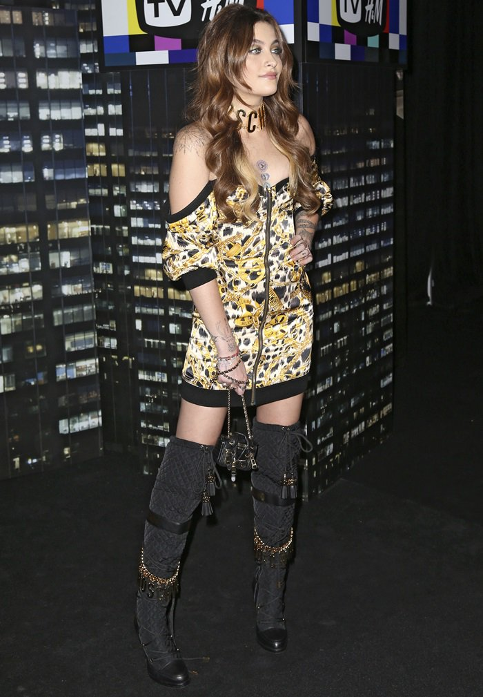 Paris Jackson wearing an off-the-shoulder leopard print dress with Moschino x H&M boots