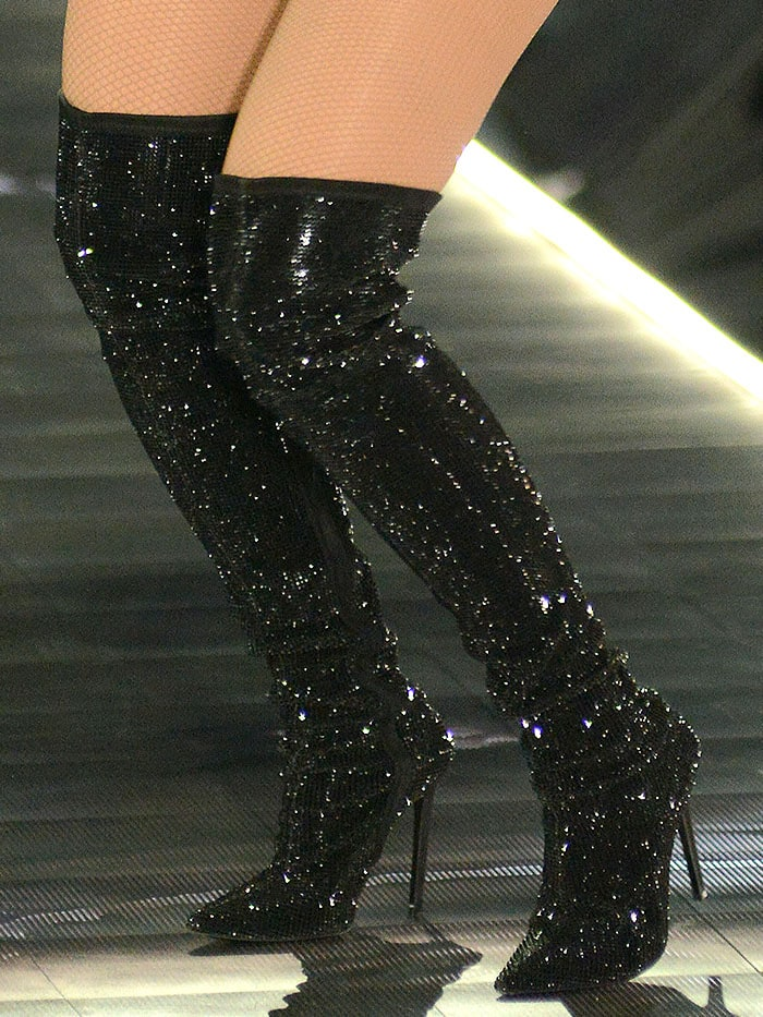Details of the Versace crystal-encrusted black thigh-high boots on Rita Ora