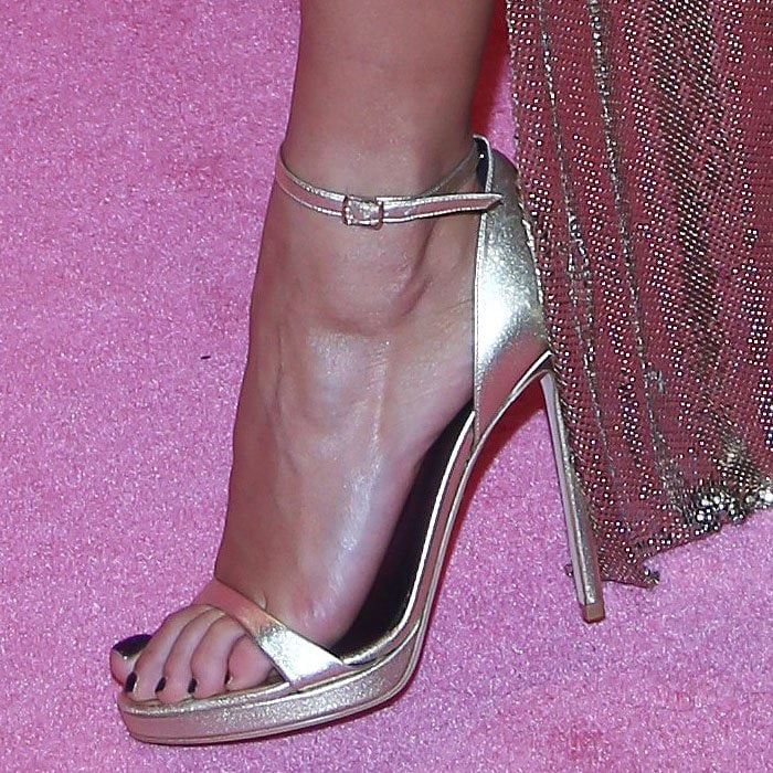 Rita Ora's feet in gold Versace ankle-strap sandals