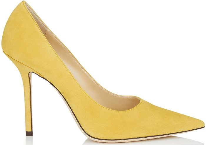 The classic point toe pump is outfitted in saffron suede